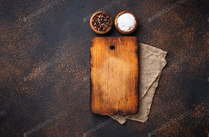 Empty vintage cutting board and spices