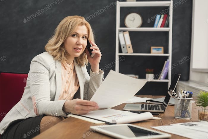 Successful businesswoman at work talking on phone