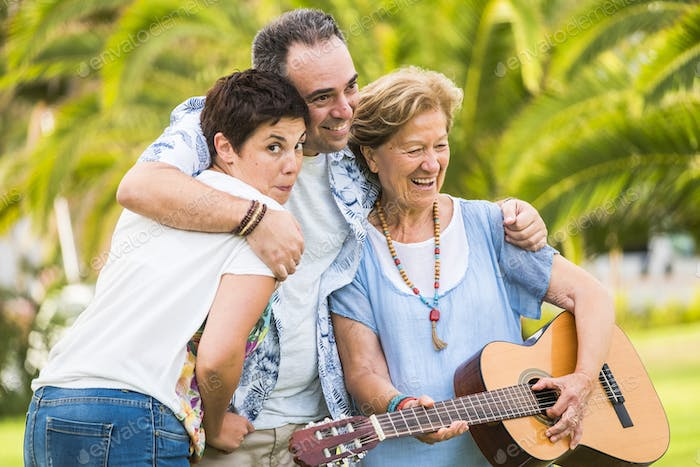 Different mixed ages generations together having fun in familyh portrait leisure activity