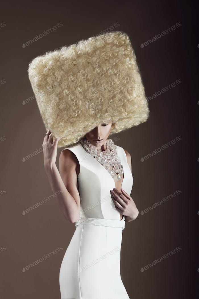 Extravagance. Woman in futuristic wig