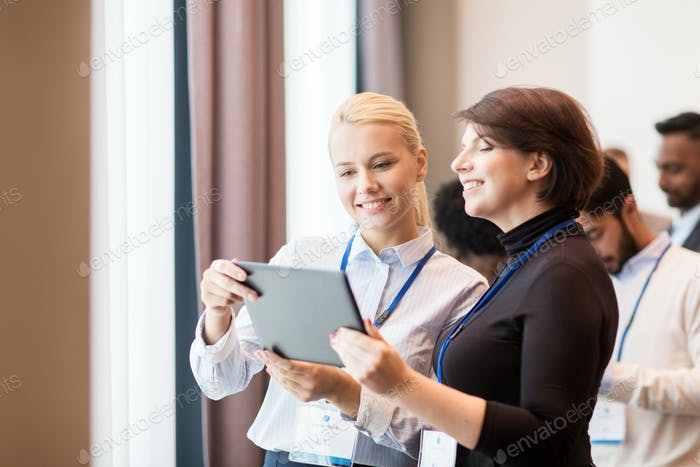 team with tablet pc at business conference