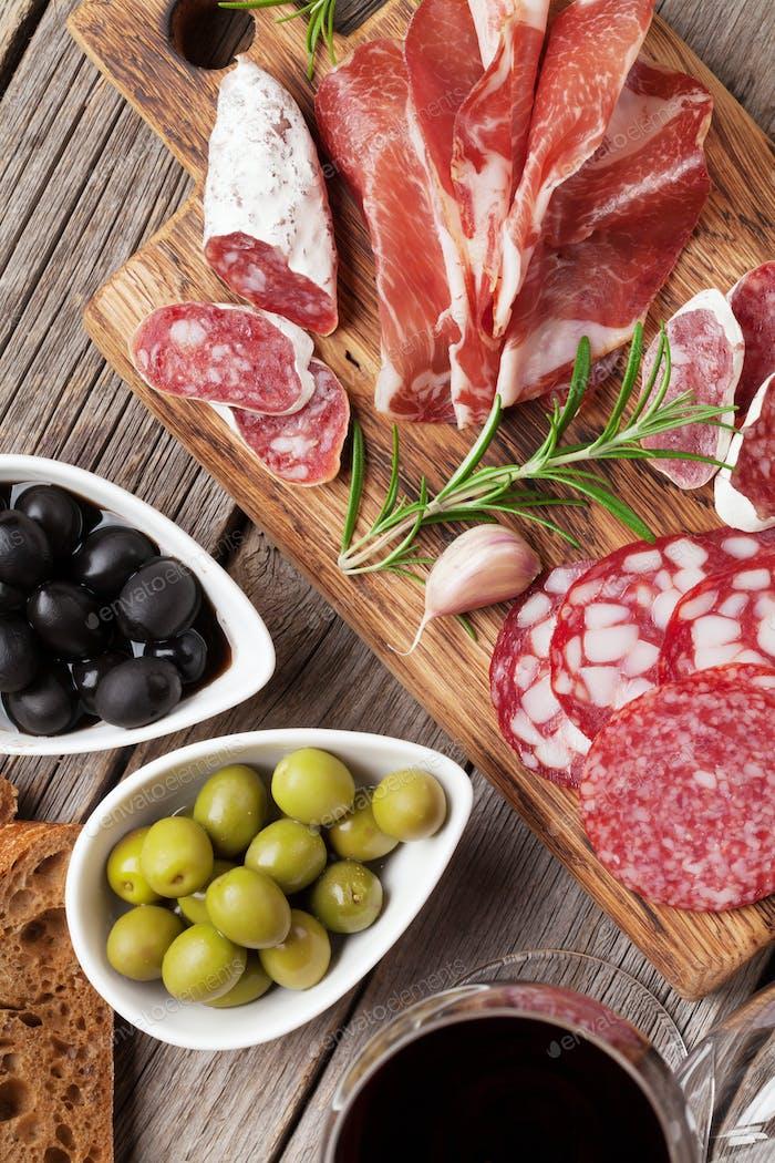 Salami, ham, sausage, prosciutto and wine