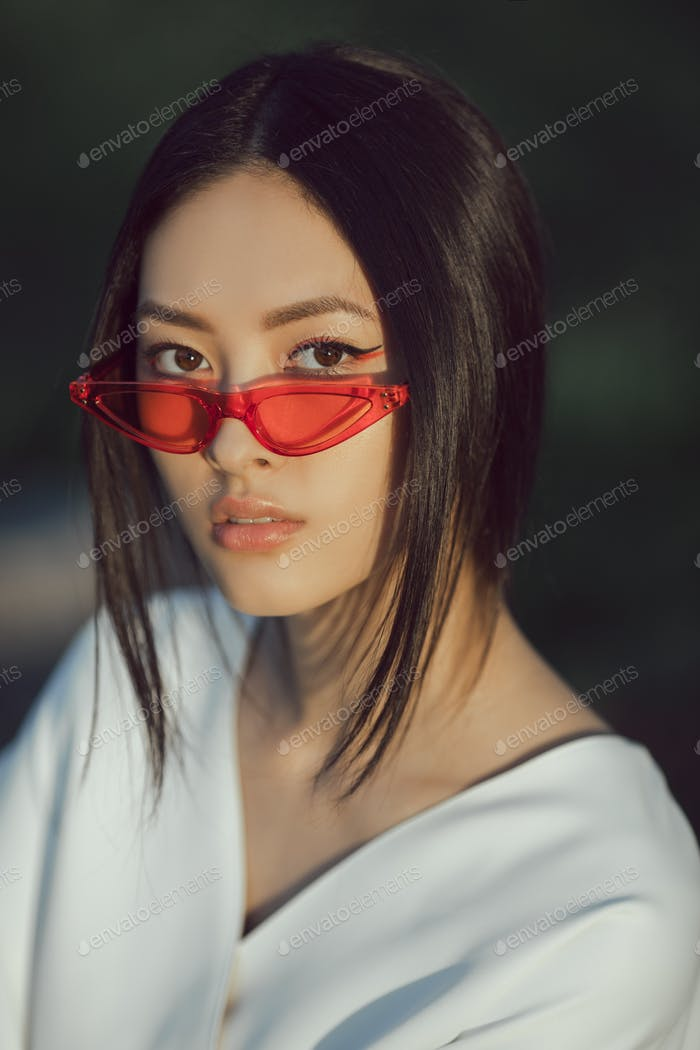 Asian woman fashion close-up portrait outdoors