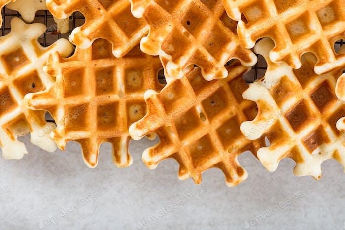 Traditional homemade belgian waffles on light background