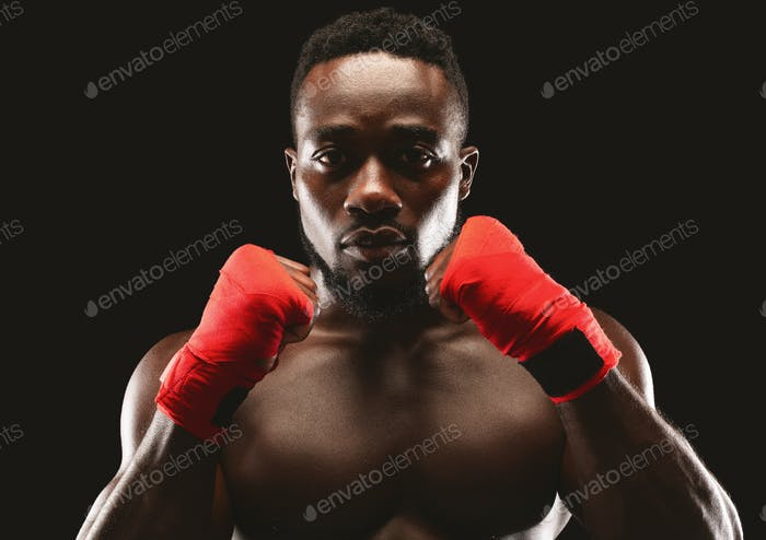 Portrait of professional fighter in defence pose