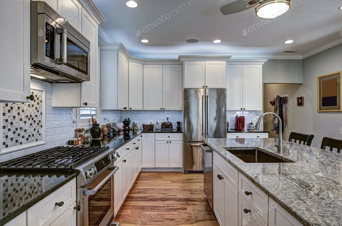 High-end luxury kitchen with granite countertops and white cabin