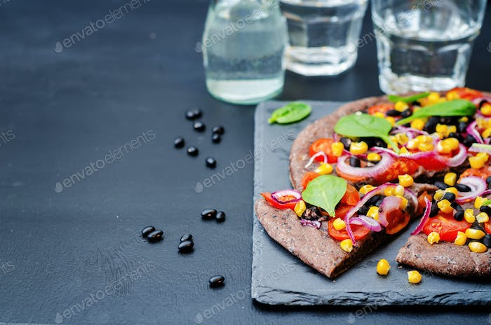 Black beans crust pizza with corn, spinach, tomatoes, black bean