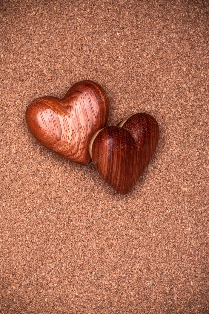 Two wooden hearts on rustic wood background. Valentines days concept.