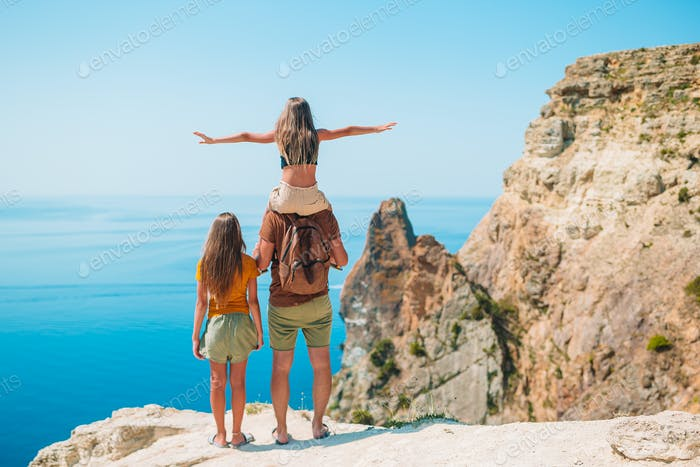 Happy beautiful family on summer vacation in mountains
