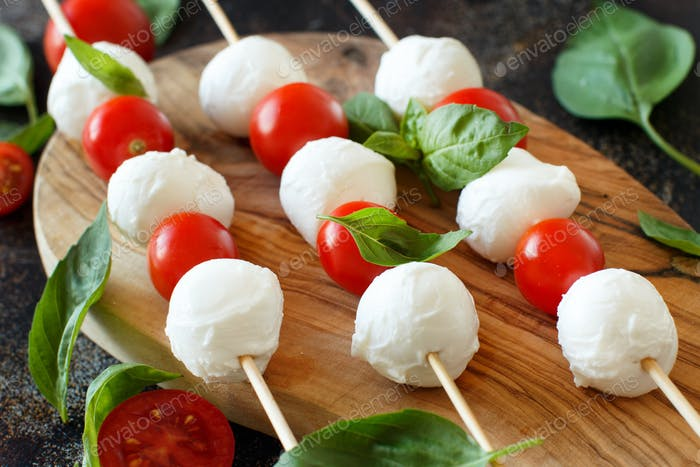Italian cheese mozzarella with tomatoes and basil