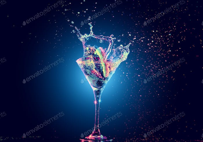 Colourful cocktail in glass with splash