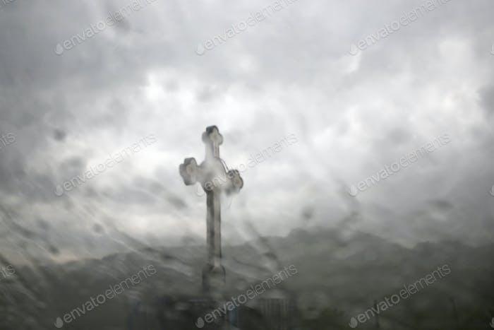 Cross and rain