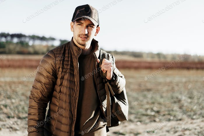 Portrait of a young man in sport trekking outfit standing