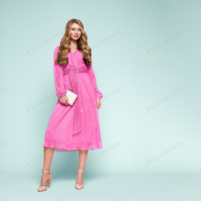 Blonde young woman in elegant pink dress