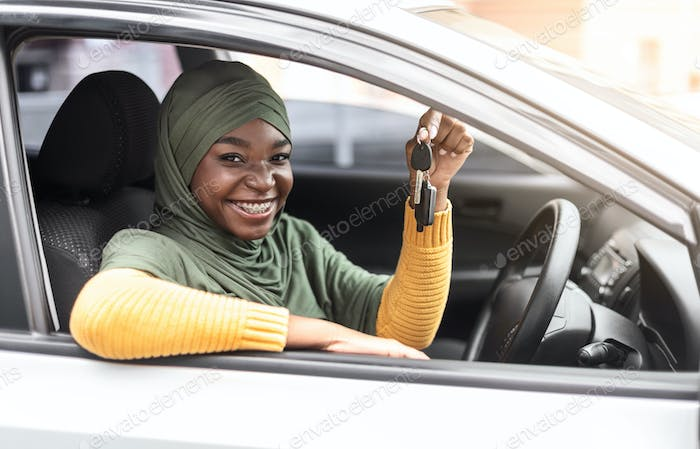 Buying New Car. Happy Black Muslim Woman Showing Keys Of Her Automobile