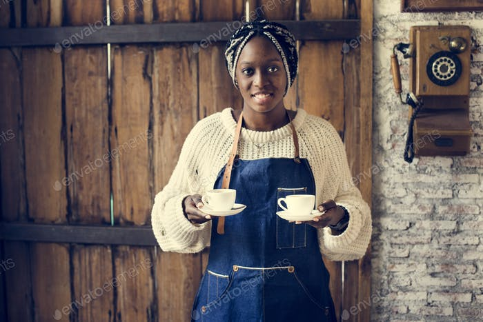 Black woman serving coffee