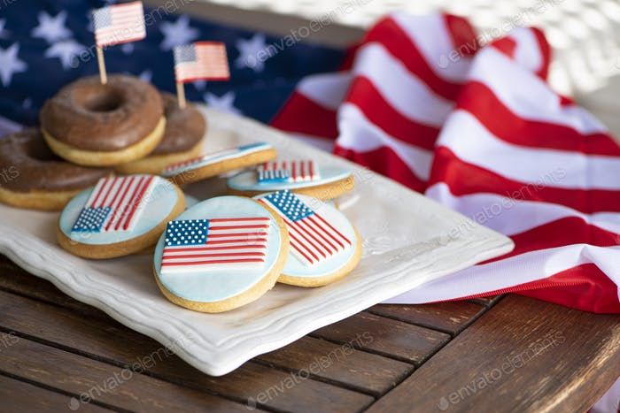 Home baking cookies icing like american flag and chocolate donuts for US National holidays