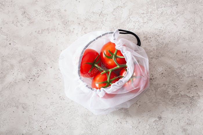 tomato vegetables in reusable mesh nylon bag, plastic free zero waste concept