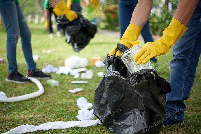 Man in rubber gloves collecting rubbish