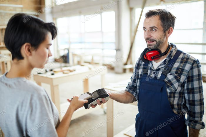 Customer paying builder using nfc technology
