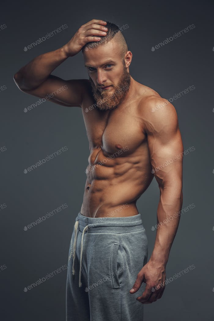 Shirtless muscular man with beard.