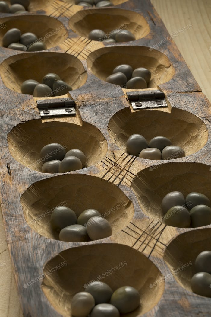 Traditional African oware game with seeds