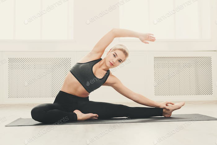 Fitness woman stretching at white background