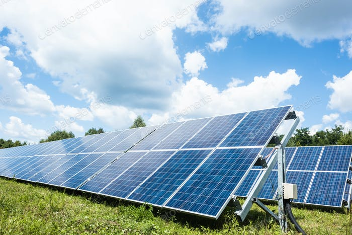 blue solar energy batteries with copy space and cloudy sky