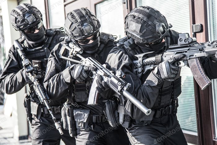 Police counter terrorist team squad storming building