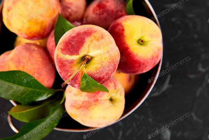 Ripe peaches in a bowl