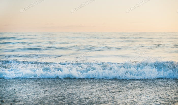 Calm Sea and beach view at sunset, pastel colors