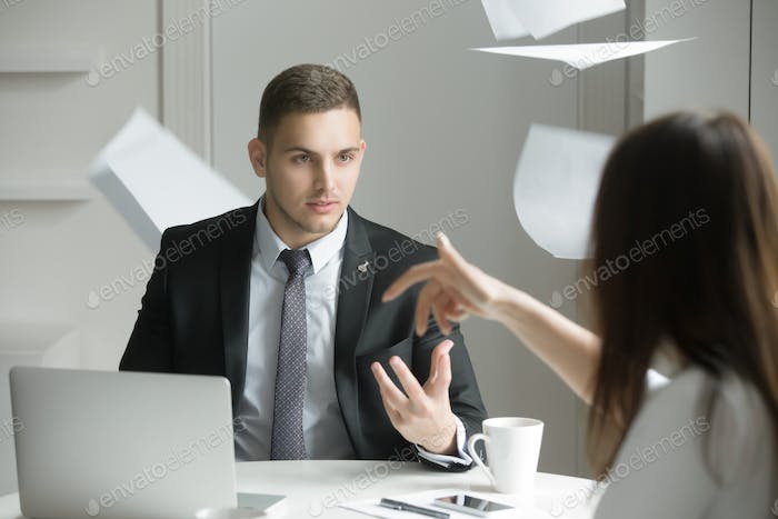 Two business people at a heated discussion