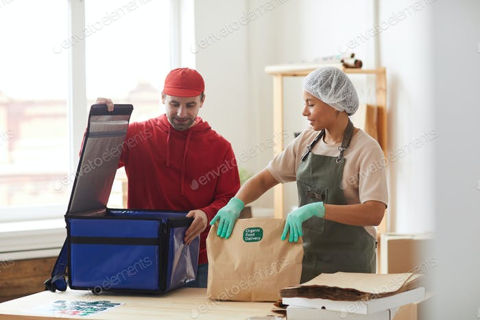 Delivery Man Packing Orders to Cool Box