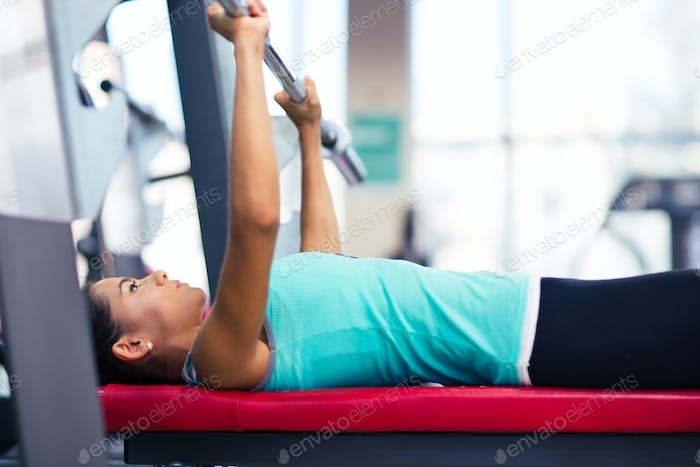 Beautiful woman work out with barbell