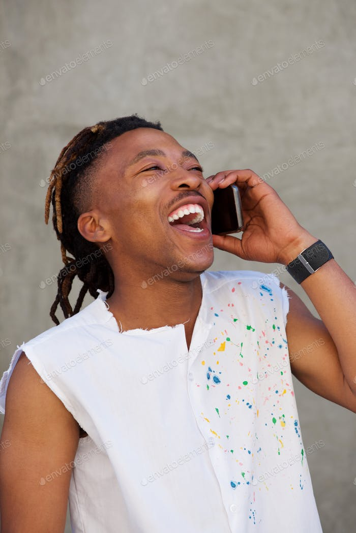 african man  laughing and talking on cellphone