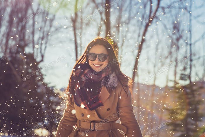 Cheerful female enjoying winter