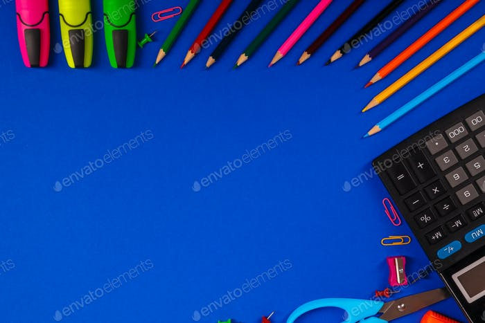 School or office stationery on blue background. Back to . Frame, copy space. Top view.  supplies