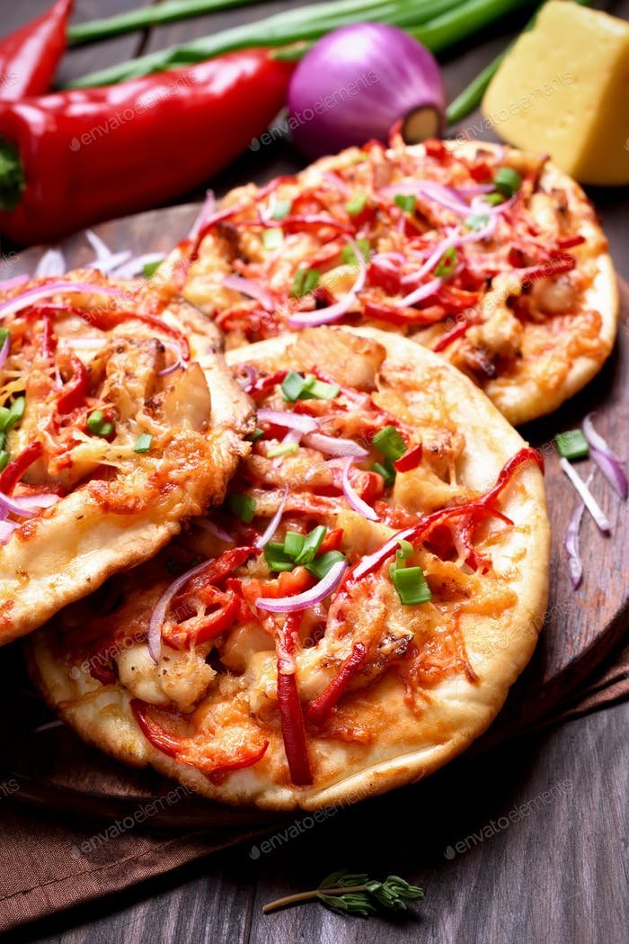Homemade pizza with chicken meat