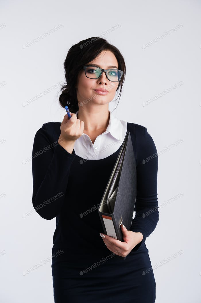 Smiling pretty young business woman in glasses holding folders with documents over white background