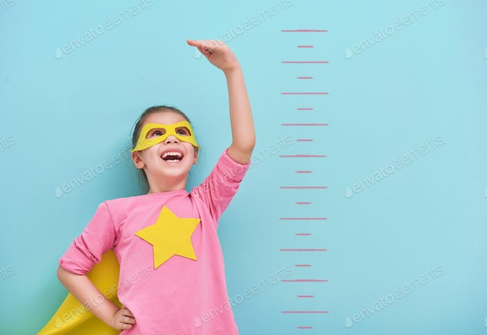 child plays superhero