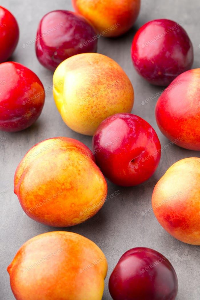 Fresh fruit on the gray background.