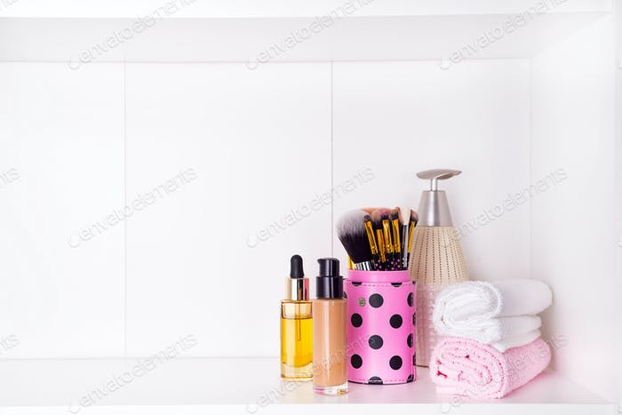 Composition with spa cosmetic and brush for face, isolated on white
