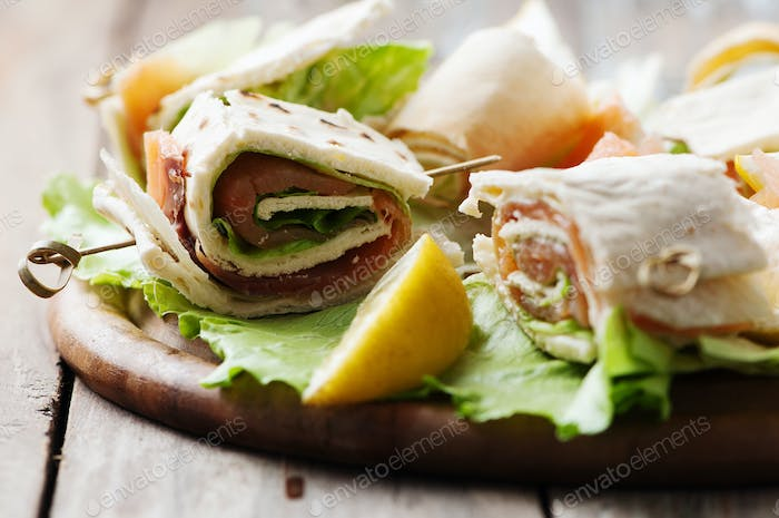 Bread rolls with salmon and salad
