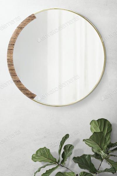 Round mirror in a gold frame psd