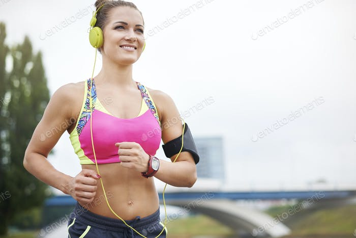 Low angle view of a jogging woman