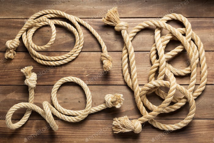 ship rope at wooden background texture