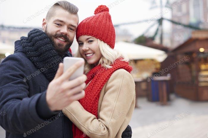 Taking selfie next to the christmas market