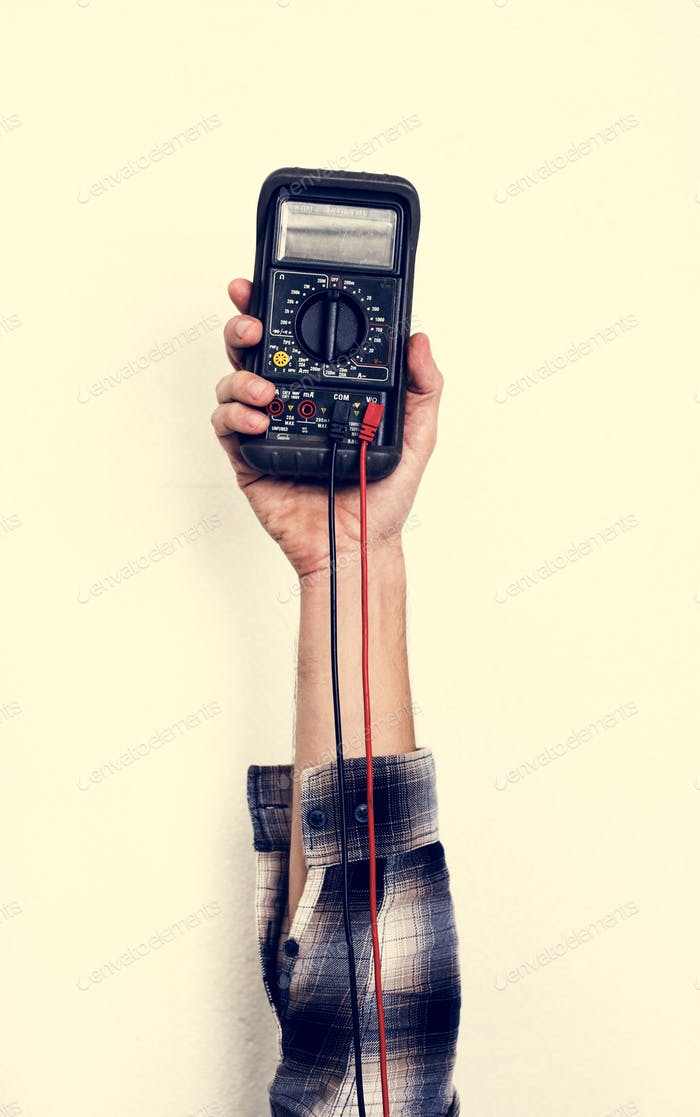 Hand holding electrics measure multimeter isolated on white