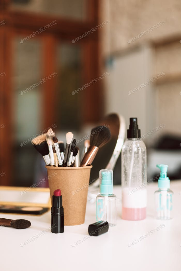 Close up cosmetics on desk isolated