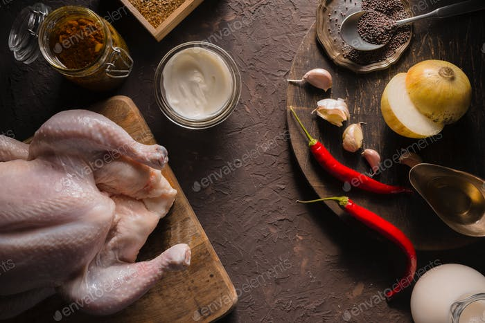 Ingredients for cooking chicken curry on the table copy space. Indian food